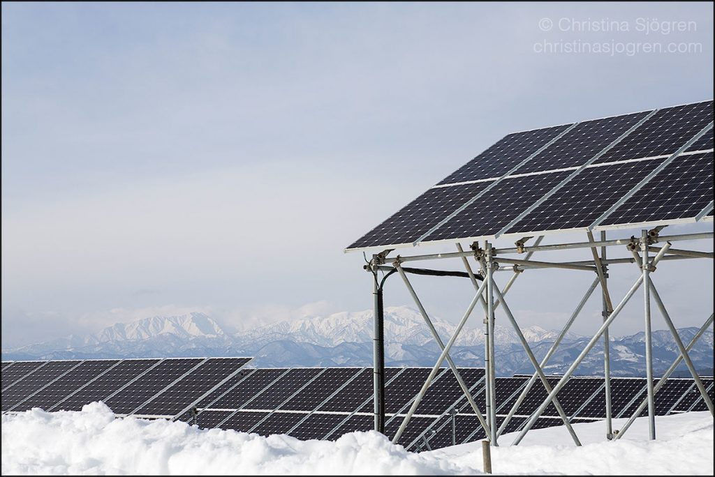Solar panels in a snowy winter landscape.