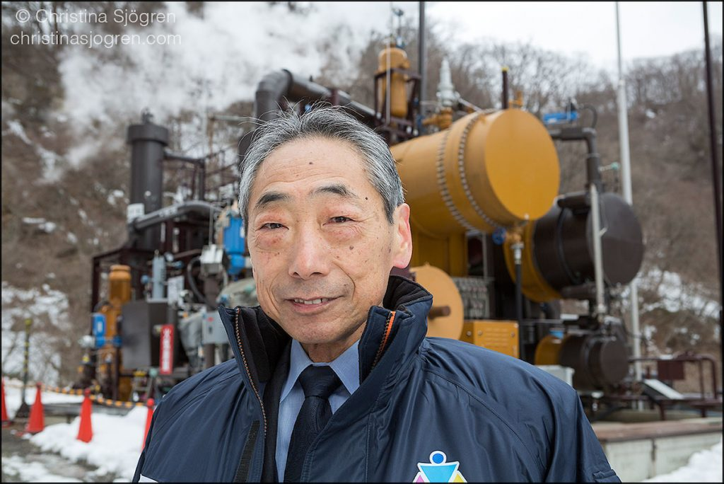 Katsuichi Kato, director of Genki Up Tsuchiyu, in front of the biothermal plant.