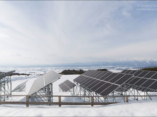 Solar panels in a wide winter landscape