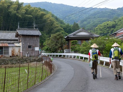 Two Shikoku pilgrims walking in the countryside