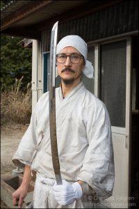 Yasha Yukawa holding a polished sword